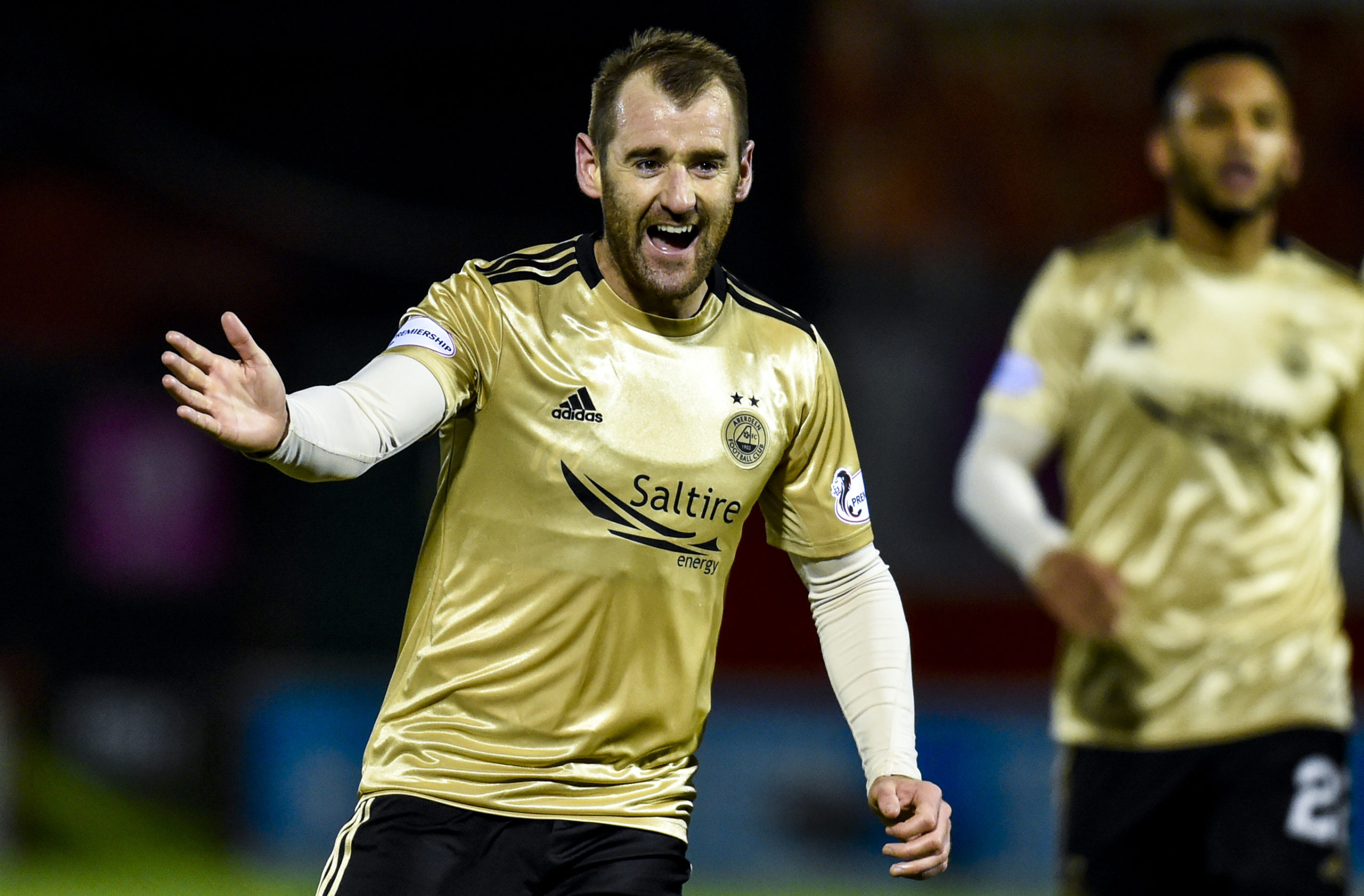 Niall McGinn celebrates after scoring to make it 2-0 to the Dons