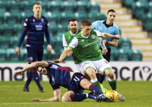 Iain Vigurs in action against Hibernian.