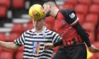 Queen's Park's Josh Doig (left) competes with Matthew Cooper during the Ladbrokes League 2 match between Queen's Park and Elgin City at Hampden Park