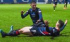 Ross County's Billy McKay celebrates with Josh Mullin after scoring to make it 1-1 during the Ladbrokes Premiership match between Ross County and St. Johnstone