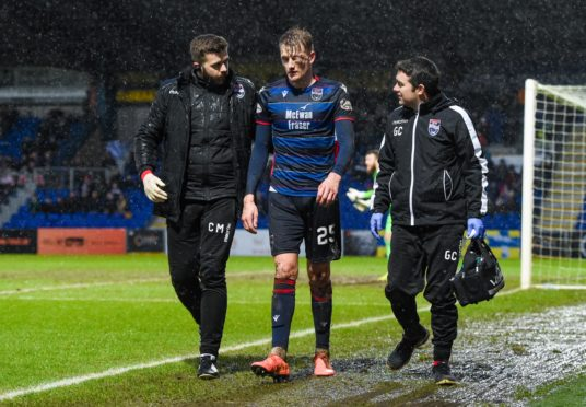 Ross County's Coll Donaldson goes off injured during the Ladbrokes Premiership match between Ross County and St Johnstone