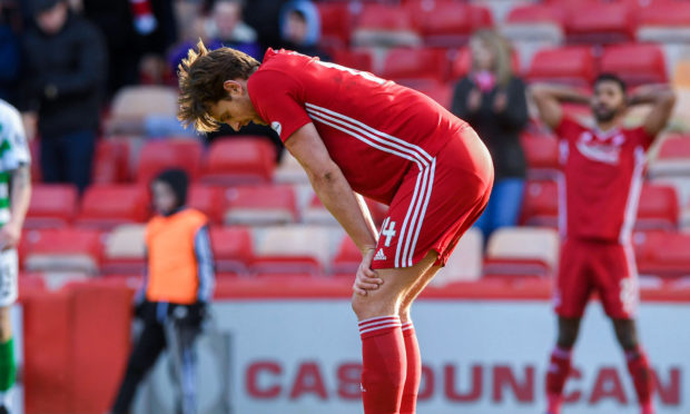 Aberdeen's Ash Taylor looks dejected at full time during the Ladbrokes Premiership match between Aberdeen and Celtic, at Pittodrie