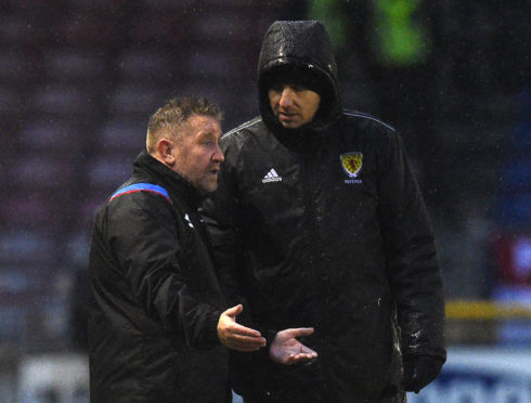 Inverness manager John Robertson appeals James Keatings' red card to fourth official Barry Cook.