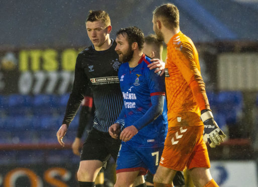 James Keatings with Rangers colts' Ciaran Dickson (left) and goalkeeper Andy Firth.