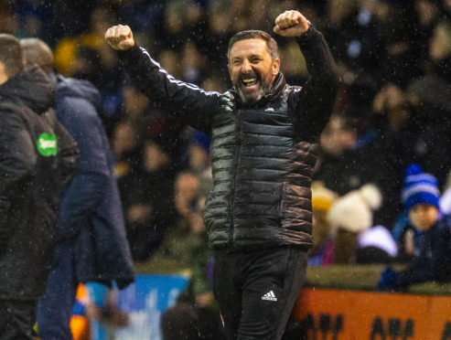 Derek McInnes celebrates his side's victory in the fifth round at Kilmarnock