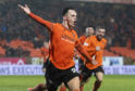Lawrence Shankland celebrates his winning goal.