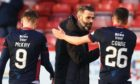 Ross County co-manager Stuart Kettlewell celebrates with Don Cowie at full time during the Ladbrokes Premiership match between Aberdeen and Ross County