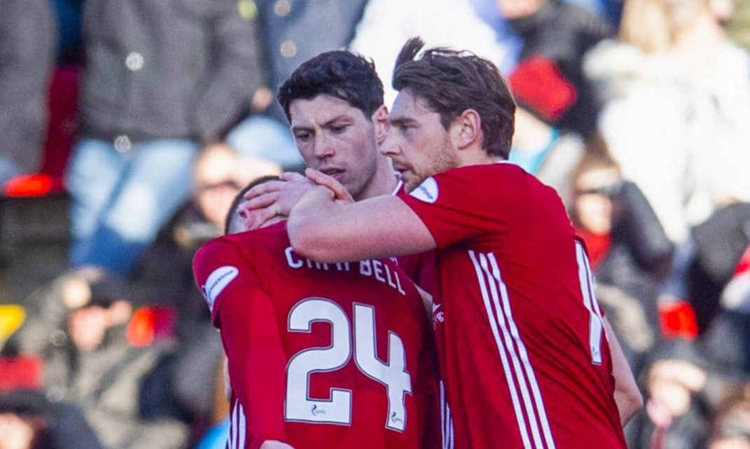 Aberdeen's Dean Campbell, left, is consoled by team-mates after being sent off during the Ladbrokes Premiership match between Aberdeen and Ross County