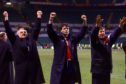 Steve Paterson (centre) salutes the Inverness fans after a famous victory over Celtic.