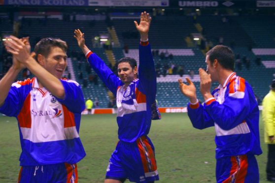 The Inverness players celebrate their victory.