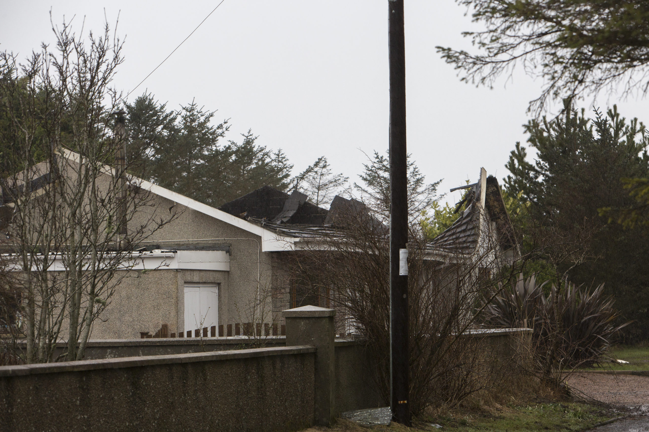 The roof of this house at Thrumster collapsed, following a fire on Monday night.