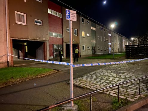 Officers cordoned off a block of flats in Tillydrone last night.   Credit: Aimee Knight