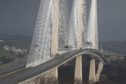 The Queensferry Crossing is closed to traffic after eight vehicles were damaged by falling ice
