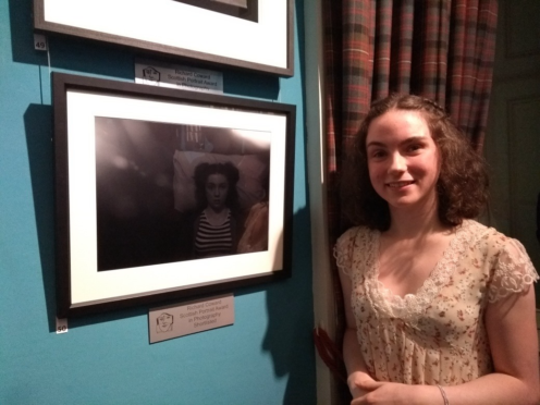 Brenna Collie with one of the pictures in her stroke recovery series