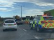 Police at the scene of the crash on the A9 in Inverness.