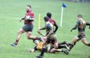 Grammar's Tom Aplin runs though the defence to score a try. Picture by Colin Rennie