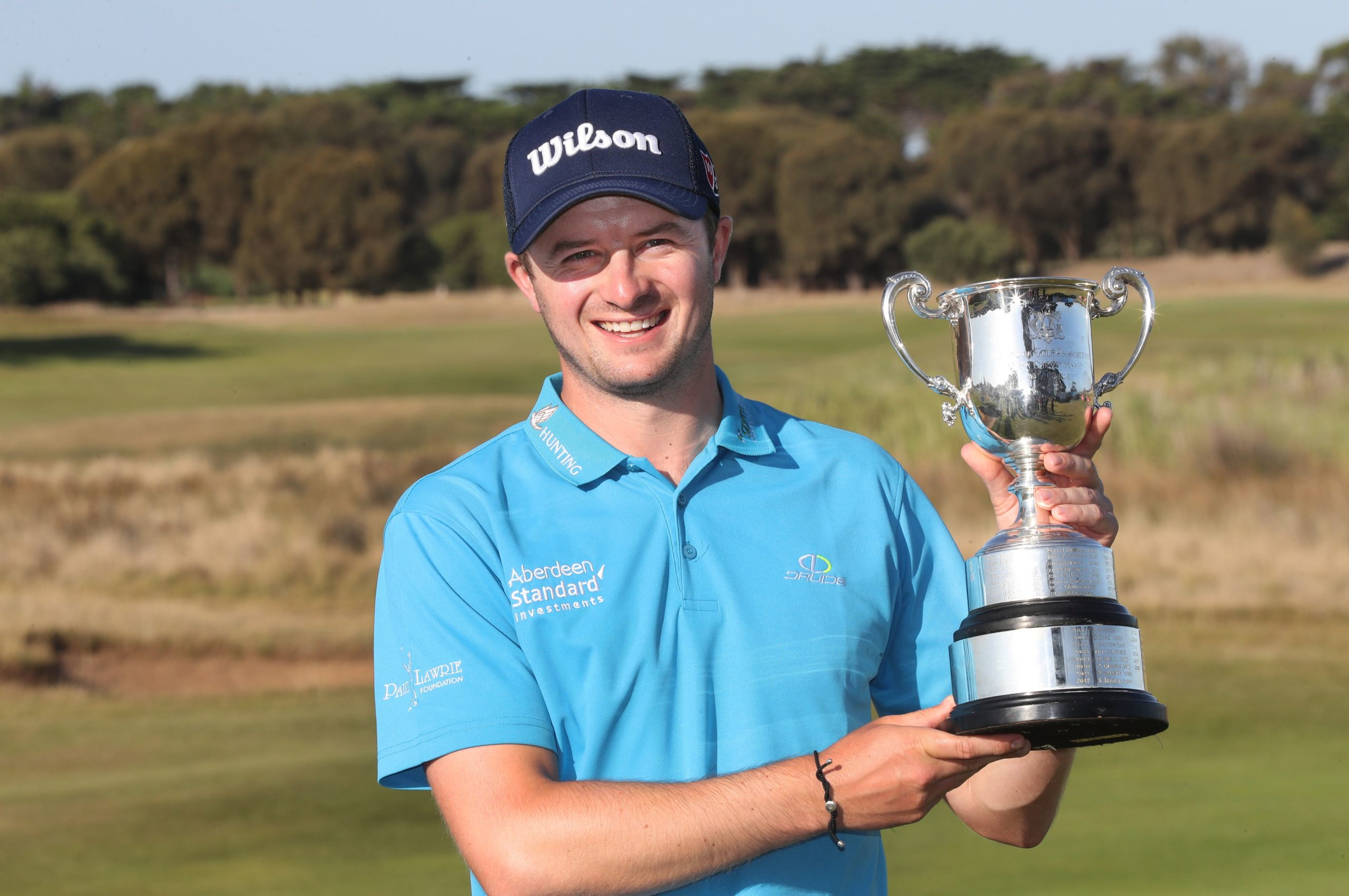 David Law of Scotland poses with the trophy after winning the Men's Victorian Open at 13th Beach Golf Links in Melbourne, Australia. Photo by DAVID CROSLING/EPA-EFE/Shutterstock