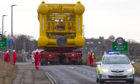 Subsea7 Towhead for the Buzzard Project under escort out of Wick, Caithness for its journey to Wester Site, Caithness this morning.