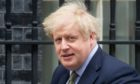 Boris Johnson leaves Downing Street to go to the House of Commons for Prime Minister's Questions.