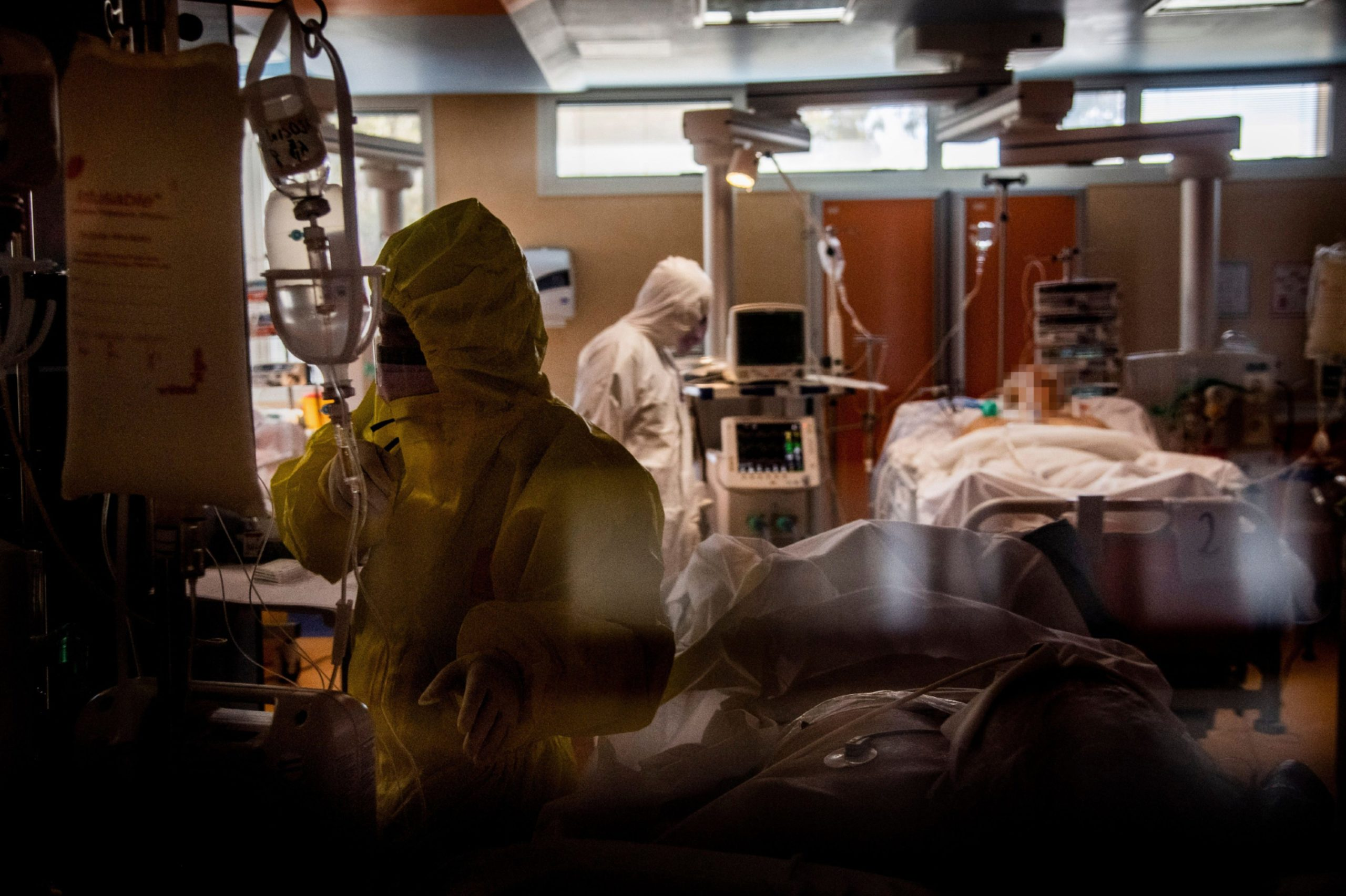 Nurses and doctors working on hospitalised coronavirus patients in the intensive care unit of a hospital in Rome. There are concerns that hospitals here might soon be facing similar pressures on intensive care units.