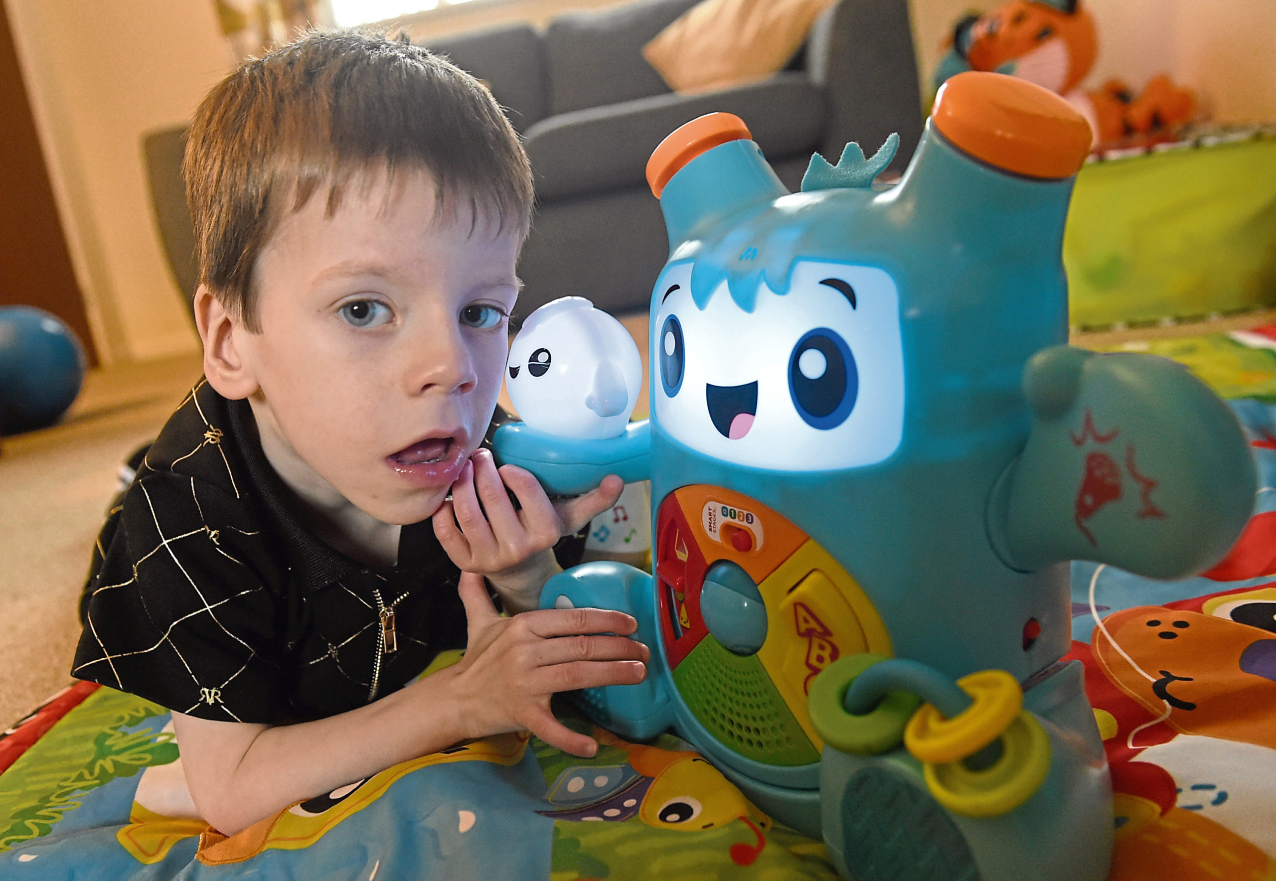 Four year old Aaron Nisbet of Invernes who suffers from an extremely rare medical condition. Picture by Sandy McCook