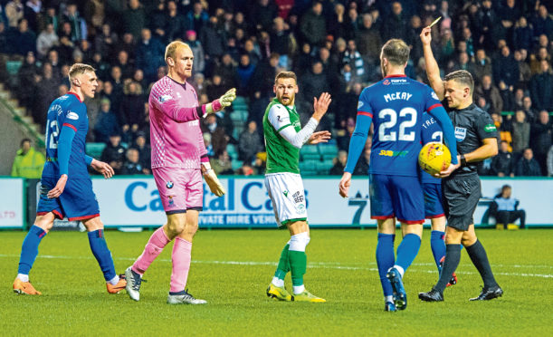 Martin Boyle goes down in the box under challenge from Mark Ridgers and is subsequently yellow carded for simulation during the William Hill Scottish Cup quarter-final.