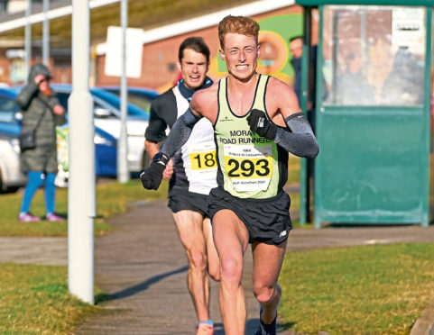 Kenny Wilson streaks away from Robbie Simpson in the Kinloss to Lossiemouth half-marathon.