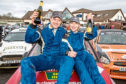 Winners of the Snowman Rally, Michael Binnie with co-driver Claire Mole, celebrate.