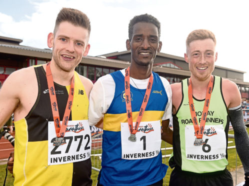 Weynay Ghebreselasie, centre, mens half marathon winner with runner-up Kenny Wilson (right) and third-placed Cameron Strachan. Picture by Sandy McCook