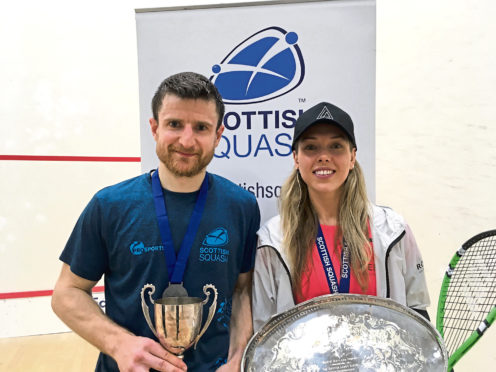 Lisa Aitken, right, with her Scottish Championships trophy.