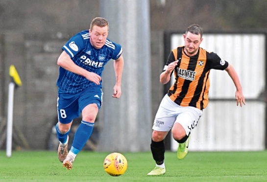 Scott Brown, left, in action for Peterhead. The skipper's efforts during the Covid-19 crisis have not gone unnoticed by his team-mates.
