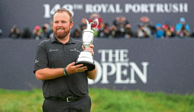 Republic Of Ireland's Shane Lowry celebrates with the Claret Jug after winning The Open Championship 2019 at Royal Portrush Golf Club.
