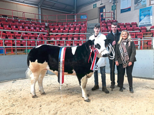 Duncan Munro, Invercharron, who stood overall champion, with judges William Moir and Rebecca Stuart.