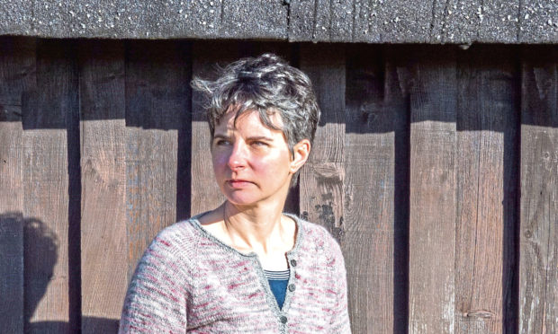 """Julie Rutter, of Black Isle Yarns, models her Culloden """"timely"""" cardigan"""
