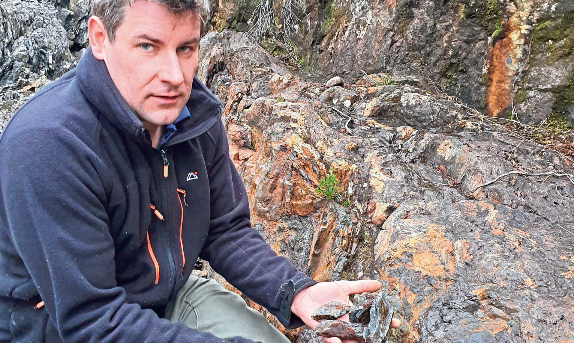 Gavin Berkenheger, managing director of GreenOre Gold, taking rock samples