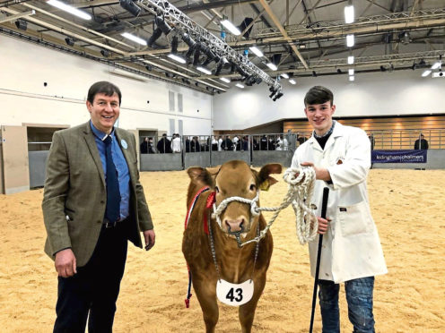 Duncan Munro, right, with the overall champion alongside the judge Willie Purdon.