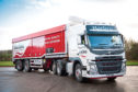 Harbro profits were down but the firm says it is ready to face the difficult road ahead