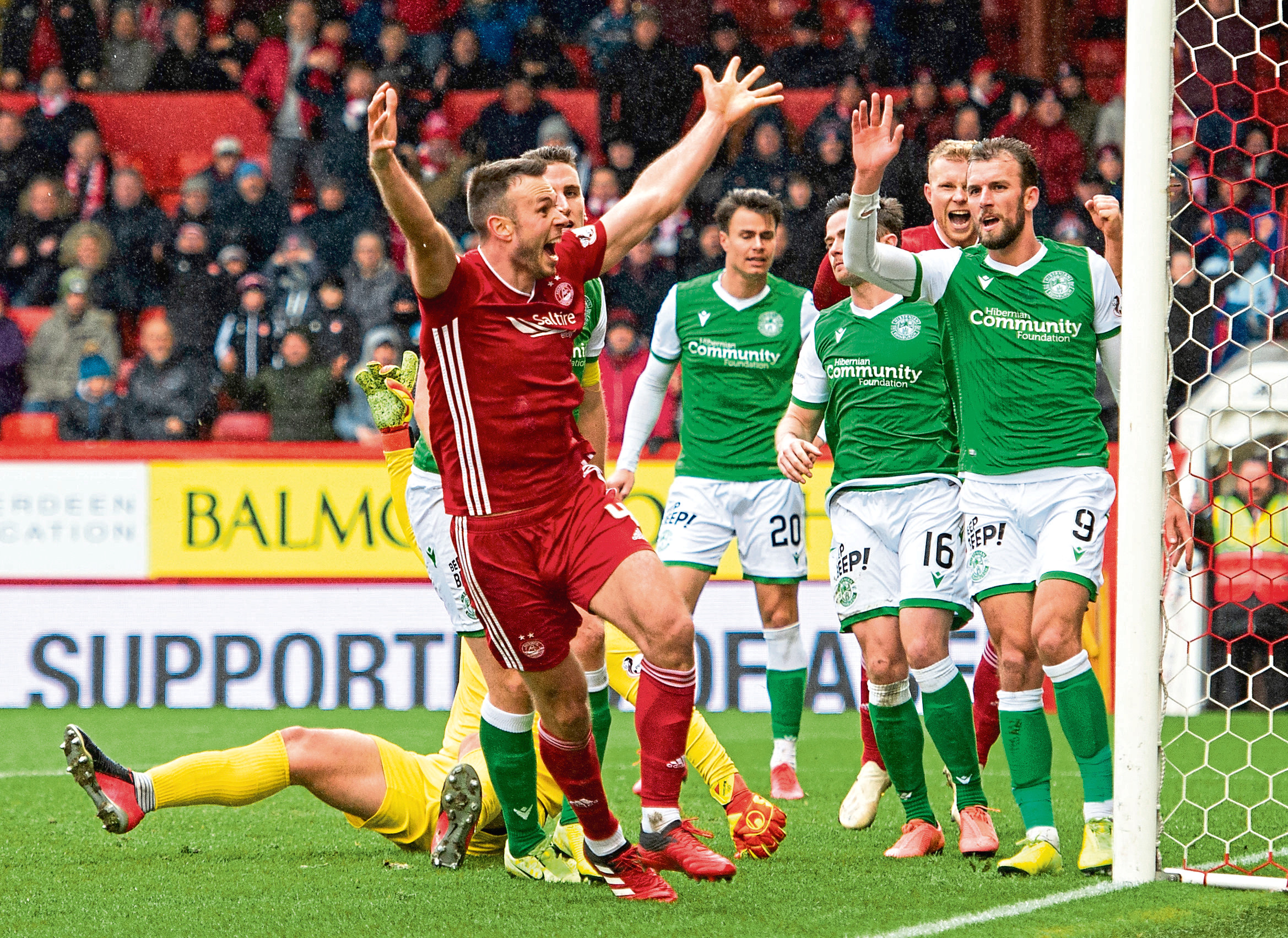 Andy Considine celebrates scoring against Hibs in the last game before the shutdown. The veteran is another player who has performed well over the campaign.