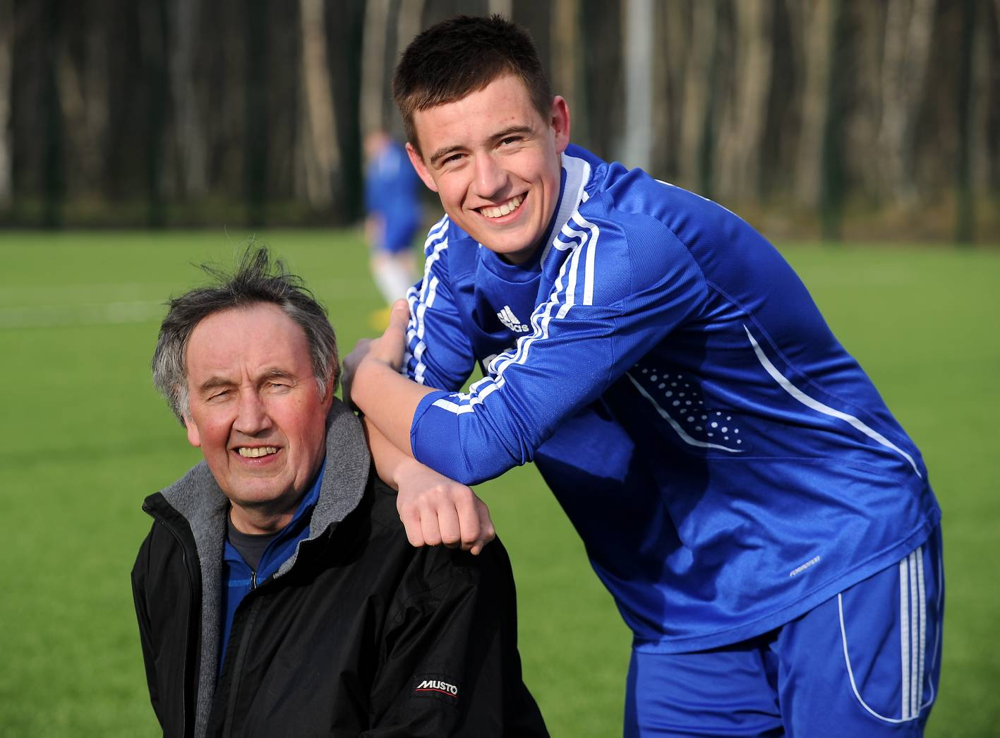 Strathspey Thistle chairman Donly McLeod with grandson James McShane, who plays for the Jags.