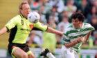 Stefan Lindqvist, left, faces off against Celtic's Darren Jackson.