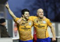 Sam Mackay (left) celebrates with former Wick Academy team-mate Gary Weir.