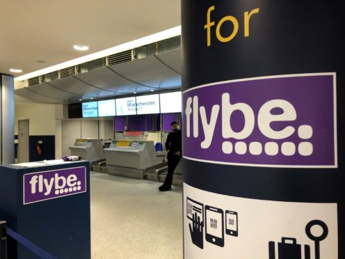 A man standing by a check-in desk at Manchester Airport as Flybe, Europe's biggest regional airline, has collapsed into administration. PA Photo. Picture date: Thursday March 5, 2020. See PA story AIR FlyBe. Photo credit should read: Pat Hurst/PA Wire