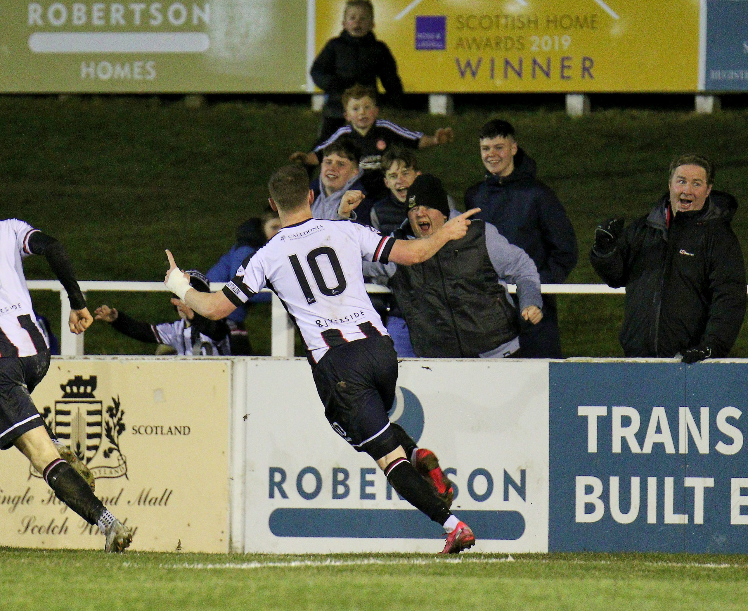 Shane Sutherland celebrates Elgin's second.