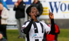 Smart Osadolor celebrates scoring the opening goal of the game for Elgin City.