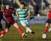 Buckie's Andrew MacAskill competes with Inverurie Locos' captain Neil McLean.