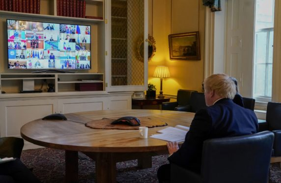 Boris Johnson in the study of No 10 Downing Street, on a video conference call to other G20 leaders during the coronavirus. Picture by Andrew Parsons/ No 10 Downing Street