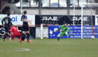 Greg Morrison fires past Wick keeper Gordon Clark to open the scoring for Brora.