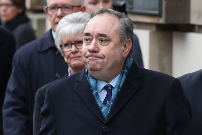 Alex Salmond leaves the High Court in Edinburgh after he was cleared of all charges.