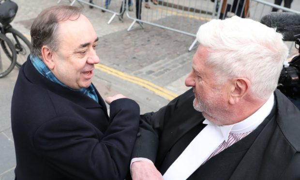 Alex Salmond elbow bumps Gordon Jackson QC as he leaves the High Court in Edinburgh.