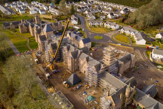 The second and final roof tower was lifted back into place at Great Glen Hall in Inverness.